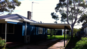 picture of a weatherboard house and carport
