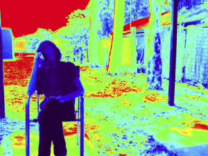 Picture of man sitting in chair with colourful filter